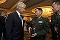 Secretary of Defense Chuck Hagel greets Deputy Chief of Staff for the People's Liberation Army Qi Jianguo (2).jpg