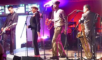 The Selecter - The Selecter playing the Milton Keynes International Festival, Milton Keynes 2016.  Vocalists Pauline Black (2nd from left) and Arthur 'Gaps' Hendrickson (3rd from left) are original members.