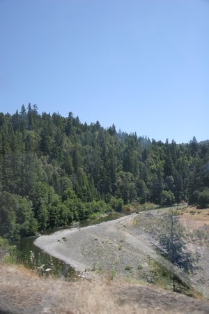 South Fork Eel River - The South Fork Eel River appears dark in deeper areas, while it is a light blue in shallows.