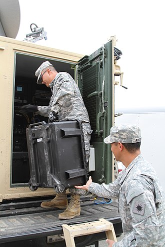 California State Military Reserve - Sgt. Tien Quach, left, the California State Military Reserve, and Sgt. Jason Roldan load equipment into an Incident Commander's Command, Control and Communications Unit (IC4U).