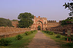 Sher Shah Suri's gate with the adjoining curon walls and Bastions and the remains of the double line of structure to its front