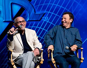 Quark (Star Trek) - Quark was portrayed by Armin Shimerman (left); his brother Rom was portrayed by Max Grodénchik (right)
