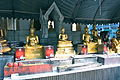Shrine at Wat Traimit Temple (8282548106).jpg