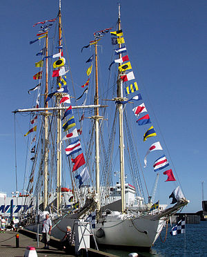 International maritime signal flags - Two sailing ships dressed overall with their signal flags.