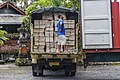Singapadu Bali Man-standing-on-the-elevating-platform-of-his-lorry-01.jpg