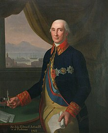 An old, pink-skinned man wears a navy frock coat adorned with medals.