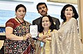 Smriti Irani presenting the Rajat Kamal Award to Sudha Dutta and Madhu Chandra (Best ArtsCultural Film) for the Non-Feature film – GIRJA, A Lifetime in Music, at the 65th National Film Awards Function, in New Delhi.JPG