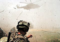 Soldier Watches Departing Helicopter During Op Omid Haft in Afghanistan MOD 45152757.jpg