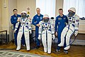 Soyuz TMA-19M crew members with their space suits.jpg