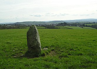 Cynwyl Elfed - Standing stone. The village of Peniel can be seen in the distance