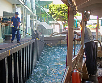 Mooring (watercraft) - Crew of Hong Kong's Star Ferry using a billhook to catch a hemp mooring rope