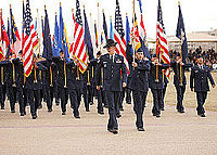 State and Federal flags carried by Air Force personnel