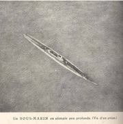 Submerged submarine seen from a plane