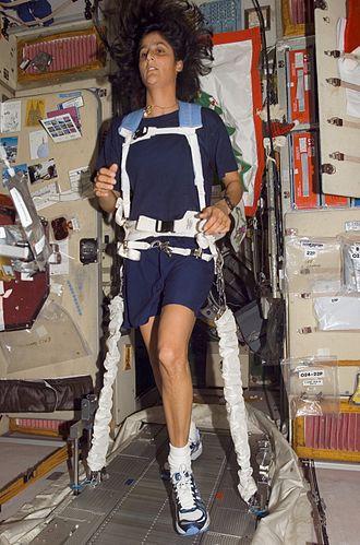 "Treadmill with Vibration Isolation Stabilization - Astronaut Sunita ""Suni"" Williams bungeed to the TVIS treadmill aboard the International Space Station."