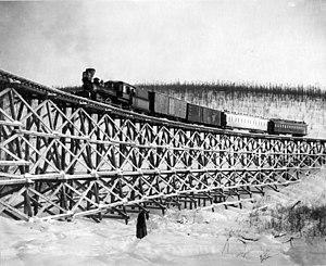Tanana Valley Railroad - Image: TVRR train crossing a trestle bridge, 1916