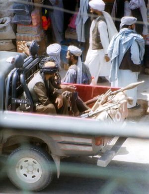 Islamic religious police - Taliban police in a pickup truck patrolling a street in Herat, in July 2001.