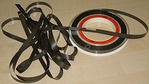 "IBM 7 track - Reel of 1/2"" tape showing beginning-of-tape reflective marker."