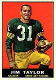"A color photo of Jim Taylor kneeling holding a football in his hand. The text ""Jim Taylor, Fullback, Green Bay Packers"" is printed in a black bar below the photo."