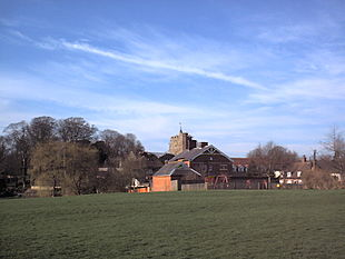Tayne Field with the Coach & Horses pub and the church in the background