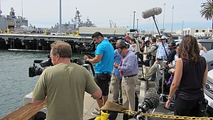 Electronic news-gathering - Television broadcast crews line up on a San Diego dock awaiting arrival of USS Vandegrift (FFG-48) crew after the sea rescue of the Kaufman family, 2014