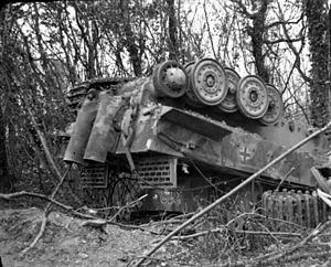 503rd Heavy Panzer Battalion - A Tiger I of the 503rd battalion overturned at Manneville by the bombing during Operation Goodwood.