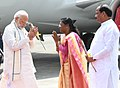 The Prime Minister, Shri Narendra Modi being welcomed by the Governor of Jharkhand, Smt. Droupadi Murmu and the Chief Minister of Jharkhand, Shri Raghubar Das, on his arrival, at Ranchi, Jharkhand on September 23, 2018.JPG