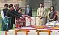 The US President, Mr. Barack Obama and the First Lady Mrs. Michelle Obama paying floral tributes, at the Samadhi of Mahatma Gandhi, at Rajghat, in Delhi on November 08, 2010.jpg