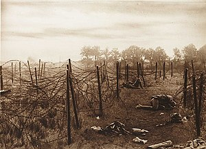 "Battle of Mont Saint-Quentin - ""The gaps in the wire near Anvil Wood were death traps"", reads the caption of a contemporary photograph of the battlefield."