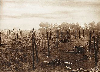 """Battle of Mont Saint-Quentin - """"The gaps in the wire near Anvil Wood were death traps"""", reads the caption of a contemporary photograph of the battlefield."""