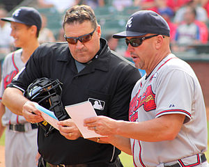 Tony Randazzo (umpire) - Randazzo (left) confers with Atlanta Braves manager Fredi González in 2014