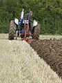 Tractor with two-furrow plough.jpg