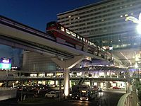 Train of Kitakyushu Monorail arriving at Kokura Station at night.JPG