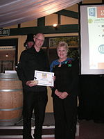 Minister Annette King standing next to Rick Houghton, who is holding a certificate