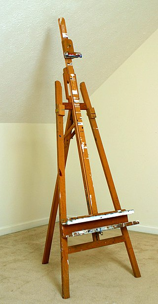 Wooden easel standing in empty room.