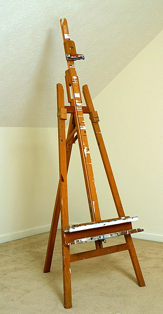Easel - An example of a tripod design easel with an inclining mechanism built in.