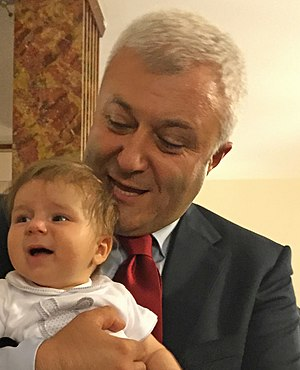 Tuncay Özkan - Özkan with his baby son at the state opening of Parliament on 23 June 2015.