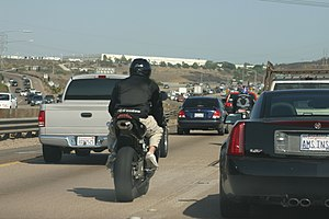 English: Two motorcycles lane splitting in Cal...