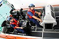 Two sailors try out the USCGC Charles Sexton's jet boat., 2014 01 28 -a.jpg