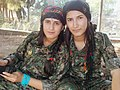 Two young YPJ fighters pose for the camera.jpg