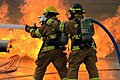 U.S. Air Force firefighters suppress fires during a training exercise on a concrete pad known as a burn pad at Spangdahlem Air Base, Germany, Jan. 8, 2014 140108-F-OP138-170.jpg