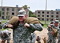 U.S. Army students assigned to Naval Construction Training Center Gulfport, Miss., fill and carry sandbags at the center Aug. 27, 2012, in preparation for Tropical Storm Isaac 120827-N-AW868-041.jpg