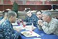 U.S. Marine Corps Brig. Gen. Rex C. McMillian, right, the commanding general of the 4th Marine Aircraft Wing, chats with Sailors and Marines aboard the amphibious assault ship USS Iwo Jima (LHD 7) off the coast 120416-A-XJ577-071.jpg