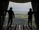 U.S. Marines stand at the back of a KC-130J Hercules aircraft to observe a drop zone over Basa Air Base, Pampanga province, Philippines, during mass supply load training Oct. 2, 2013, during Amphibious Landing 131002-M-GX379-407.jpg