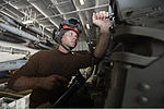 U.S. Navy Aviation Electrician's Mate Airman Kevin Williamson, assigned to Helicopter Maritime Strike Squadron (HSM) 75, works on an MH-60R Seahawk helicopter in the hangar bay of the aircraft carrier USS 131005-N-TW634-004.jpg