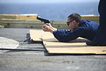 U.S. Navy Fire Controlman 3rd Class Kurtis Franciose fires an M9 Beretta pistol during small-arms qualifications June 10, 2013, aboard the guided missile cruiser USS Monterey (CG 61) while underway in 130610-N-QL471-143.jpg