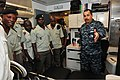 U.S. Navy Hospital Corpsman 1st Class Jose Vargas, right, shows medical treatment facilities and equipment to Congolese service members during a medical training event aboard high speed vessel Swift (HSV-2) 120516-F-VZ366-088.jpg