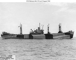 "USS Melucta (AK-131) - USS Melucta (AK-131) underway, 2 August 1944, off Jacksonville, FL., a few days after commissioning. Her conversion differs from others ships of her class in several details, including the higher splinter protection around the 5""/38 gun aft and the small but tall lattice platform aft of the deckhouse. Her camouflage is Measure 33 Design 9D."