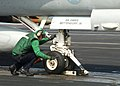 US Navy 020724-N-2329T-001 Sailor prepars and aircraft for catapult launch aboard CVN 73.jpg