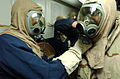 US Navy 030227-N-6141B-002 Crewmembers aboard the guided missile cruiser USS Anzio (CG 68) practice using their MCU-2P gas masks during a chemical, biological, and radiological training.jpg