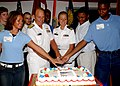 US Navy 030701-N-7041B-001 Rear Adm. Donald K. Bullard, Commander Carrier Group Six, shares in a cake cutting ceremony with newly sworn service.jpg